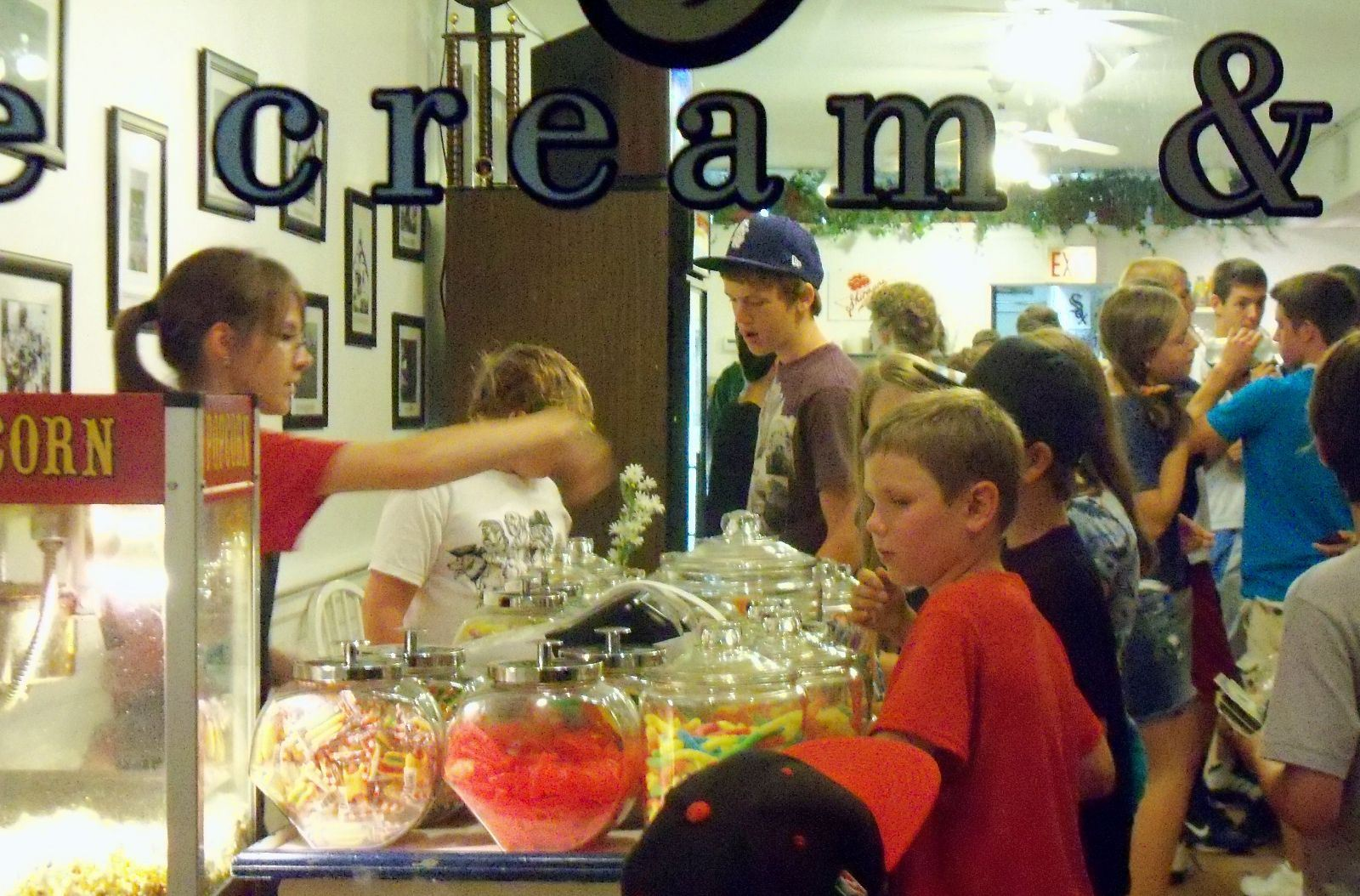 Children crowd inside a candy and ice cream shop in Clarendon Hills