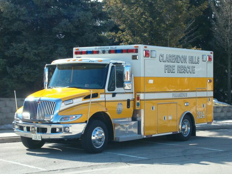 The yellow Clarendon Hills Ambulance